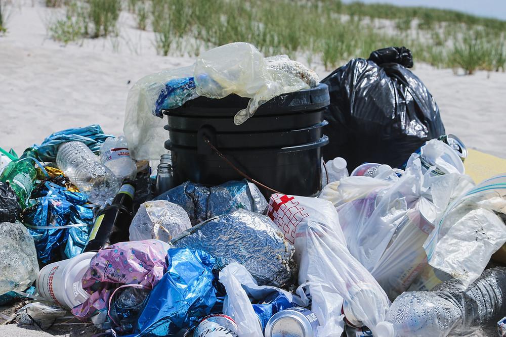 A pile of trash on the beach.