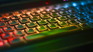 Computer keyboard with RGB color effect