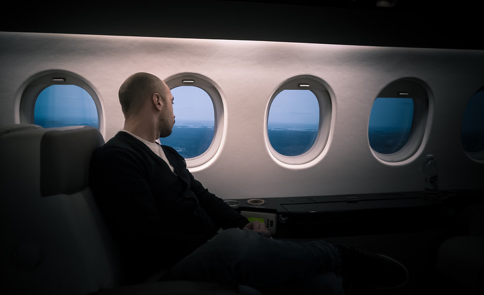 man traveling in aeroplane