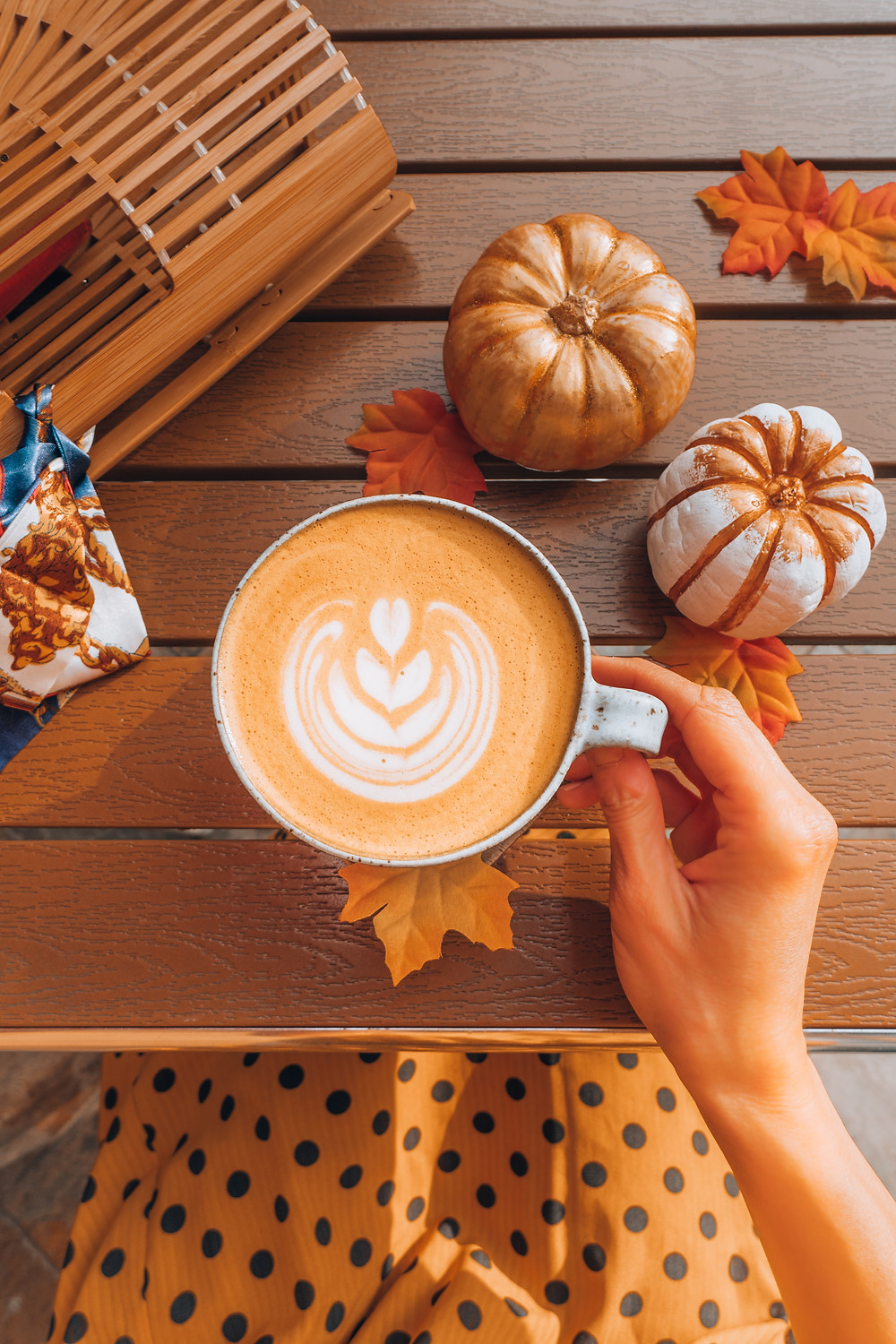 pumpkin spice latte on table with decorations