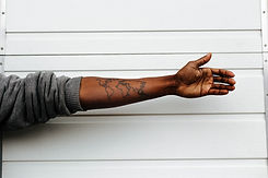Image of hand with world map tattoo