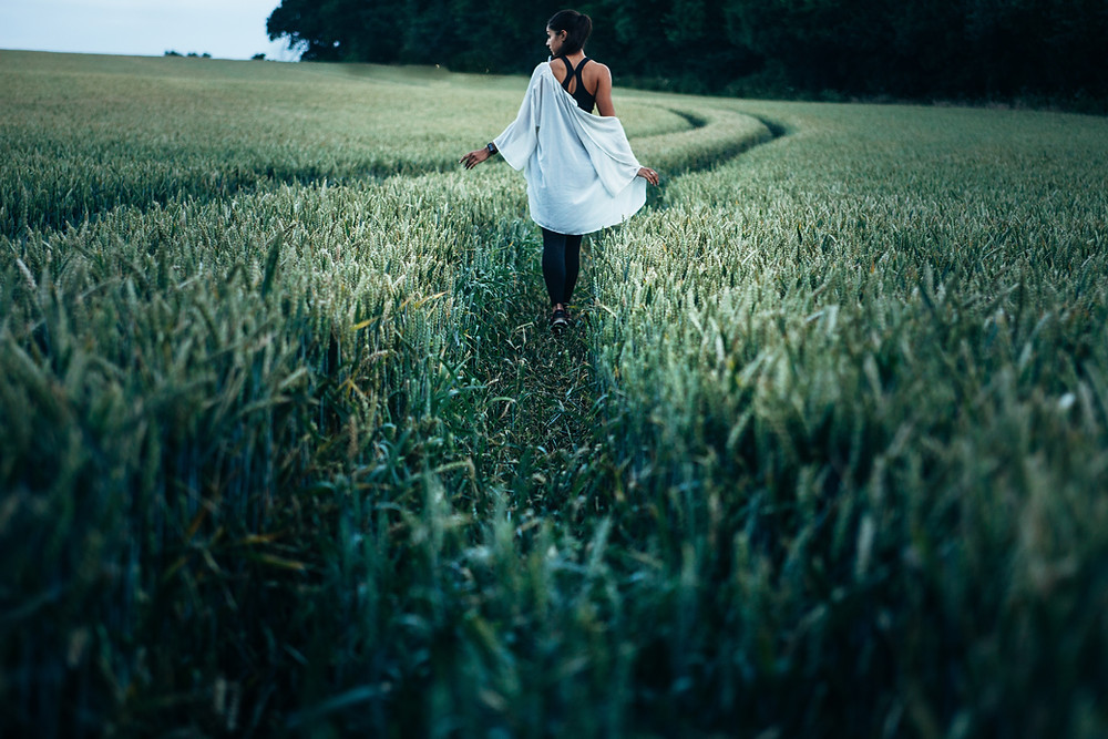 woman walking in a corn field