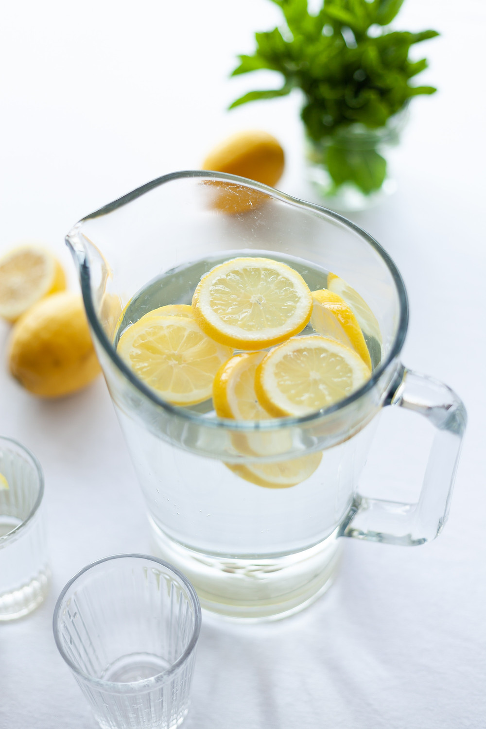 jug of water with slices of lemon in