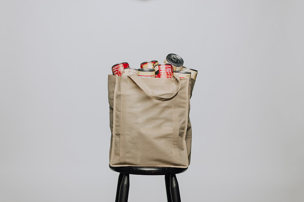 Reusable grocery bag filled with cans