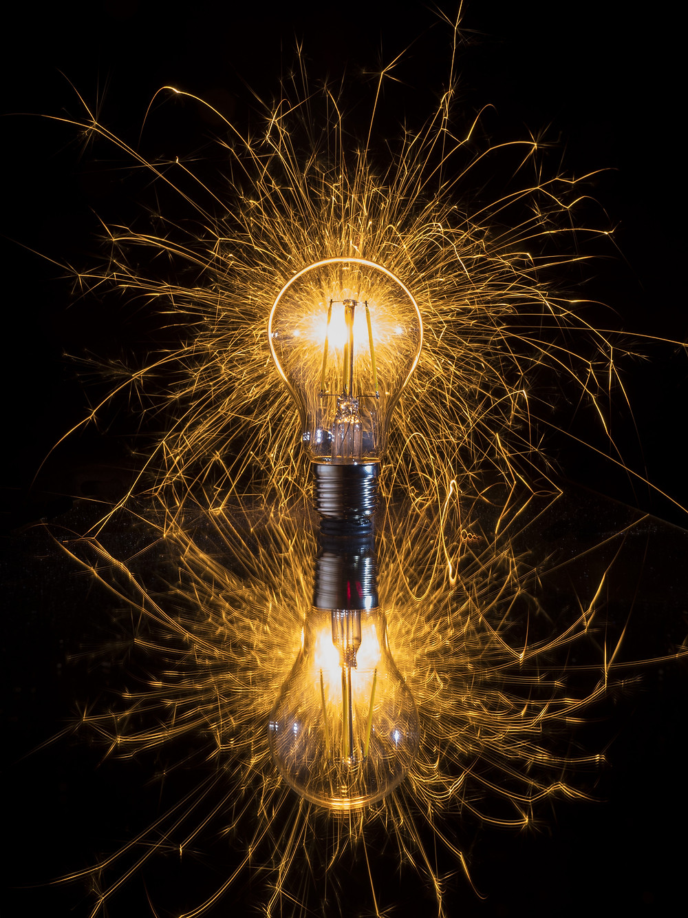 A light bulb giving off sparks.