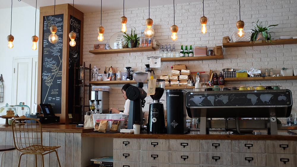 The essential equipment for any cafe includes an espresso machine and a grinder