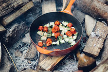 Avalanch cooking - Picture of frying pan over hot coals with vegetables inside