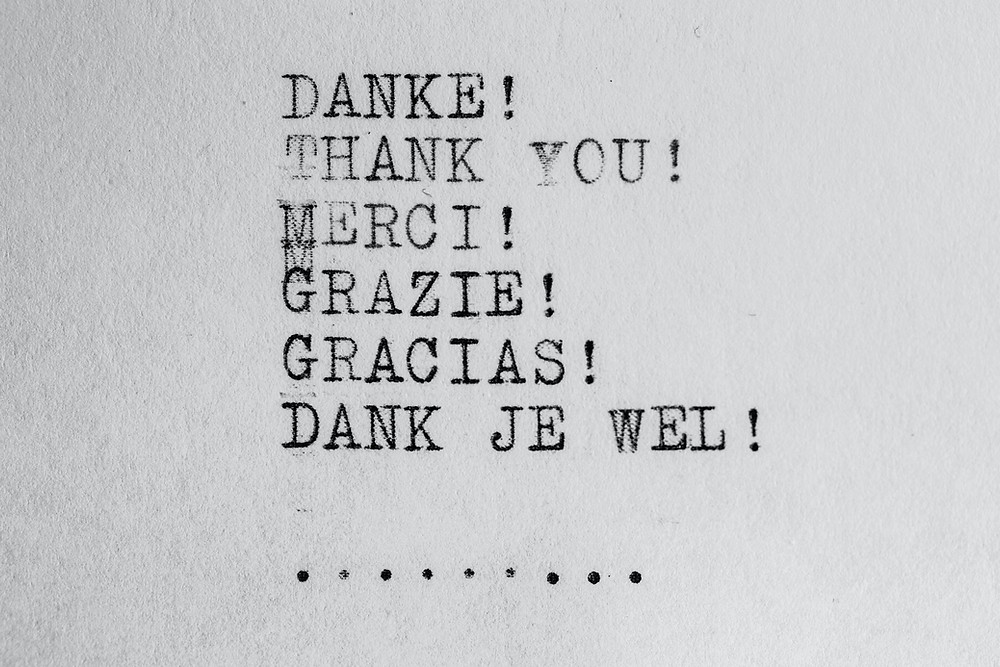 Picture shows the words Danke! Thank You! Merci! Grazie! Gracias! Dank Je Wel! in an old fashioned typewriter machine font