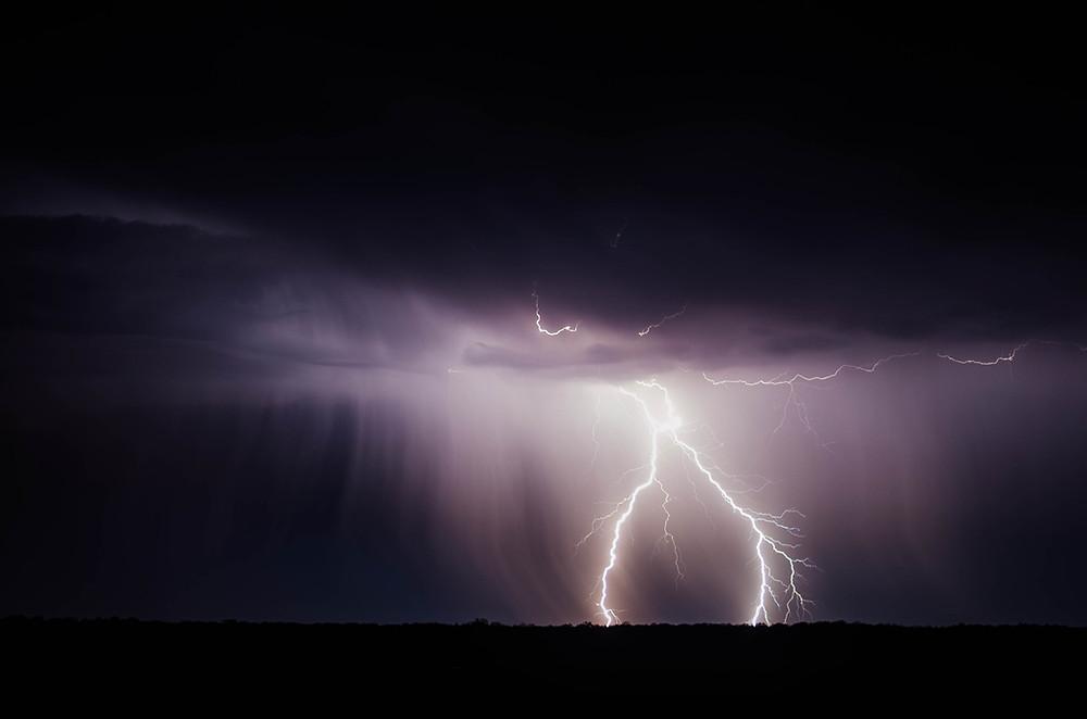 lighting striking in a dark night