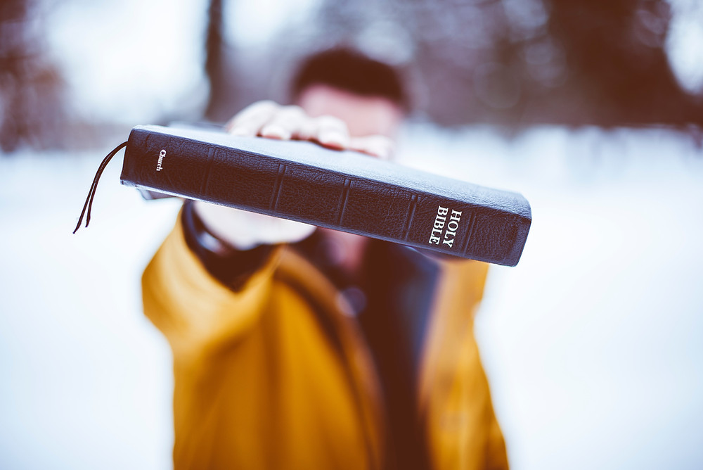 A man holding up the Bible