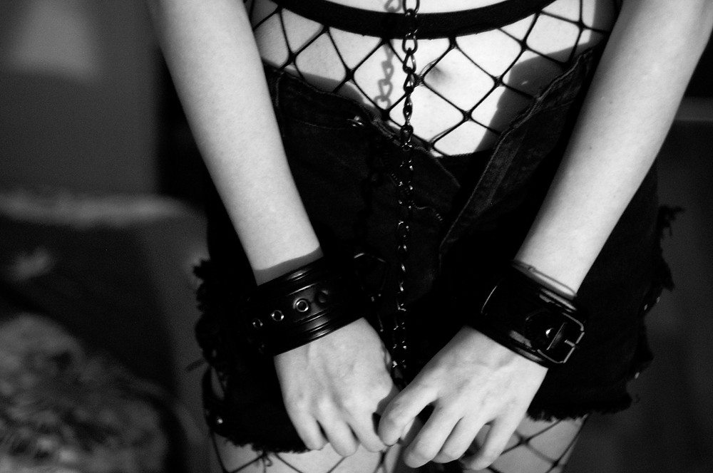 Erotic Woman with Handcuffs. Cover Page of the Free Erotic BDSM / ERotic Nurse Story by Filthybooks