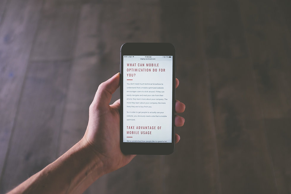 Hand holding phone reading mobile use article