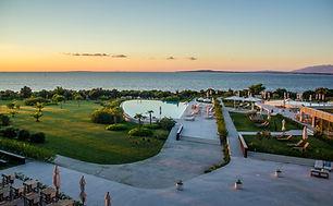 View overlooking a seaside promenade in Zadar, Croatia. A gorgeous sunset hits the sea