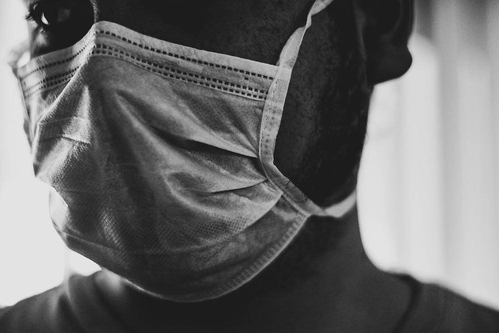 A man with a mask. COVID-19 has now caused more than 100,000 deaths globally. Photo provided by Unsplash.