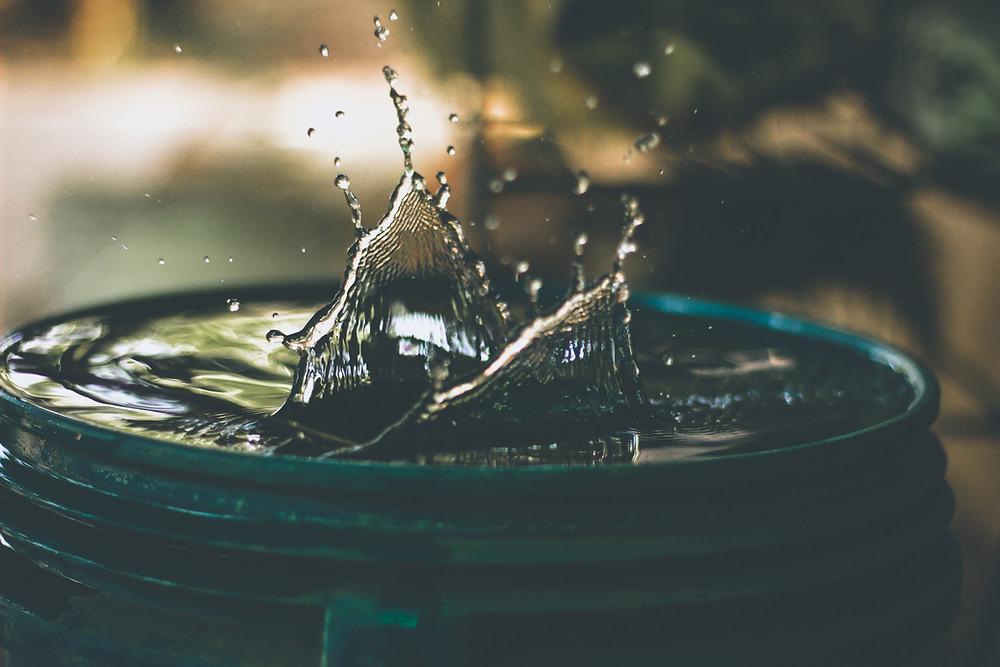 water splashing on rain barrel top