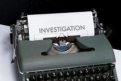"Typewriter typing under the heading ""Investigation"""