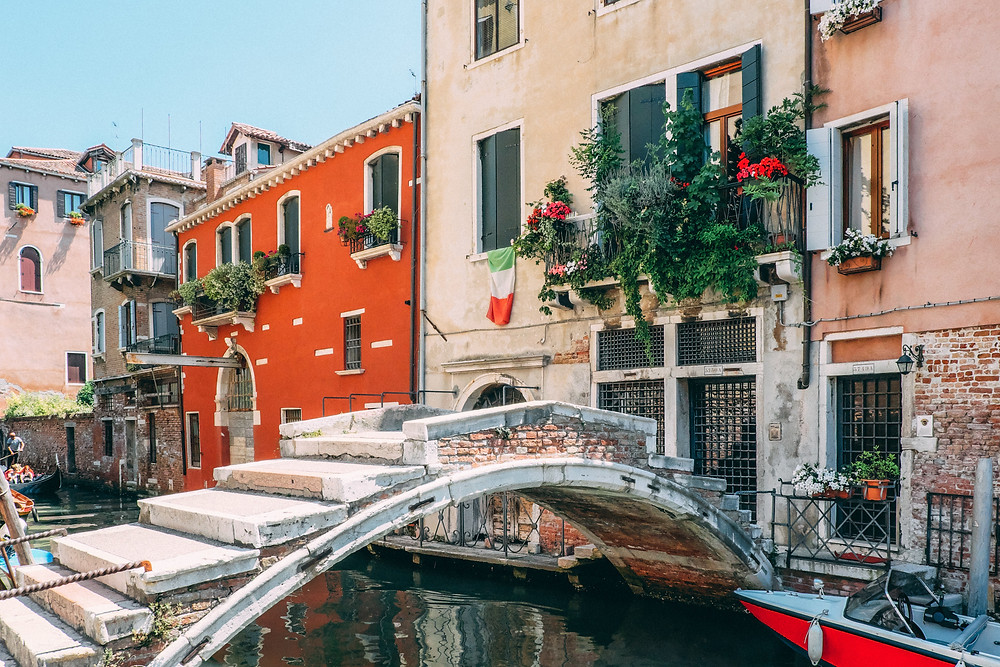 a tiny canal and bridge in Venice Italy