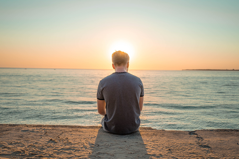 Man practices self care through a calming exercise.Catalyss Counseling provides treatment for depression, anxiety and grief and loss in Colorado through online therapy and in person counseling in the Denver area 80209 and 80210