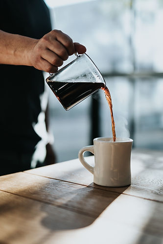 Fresh brewed coffee pouring into a mug