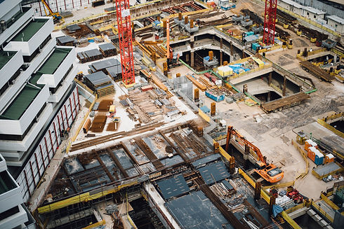 foundations-and-underground-grage-construction-project-with-concrete-forming-shoring-systems-and-cranes-by-apartment-building