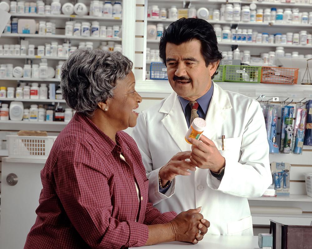 pharmacist caring for an elderly