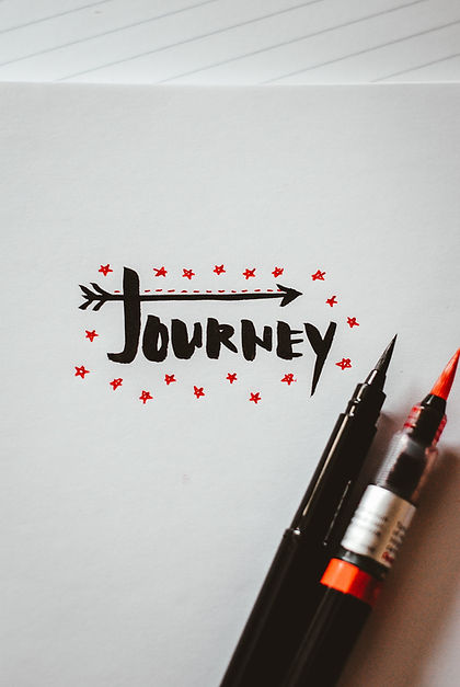 Image says journey with a couple of pens