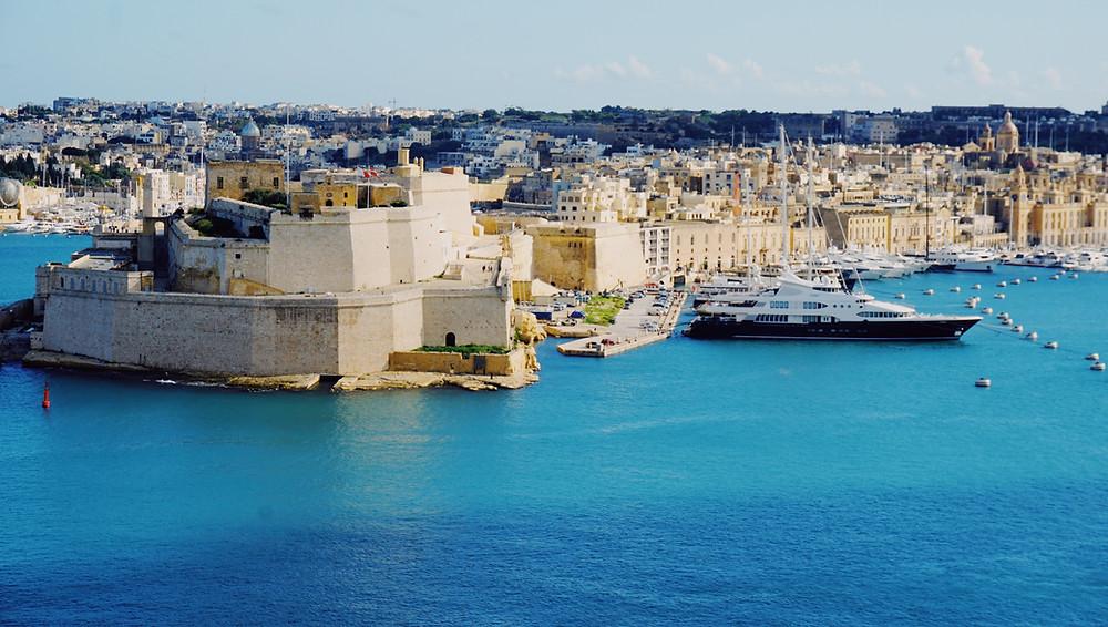 Valletta, the capital city of Malta and a Maltese flag.