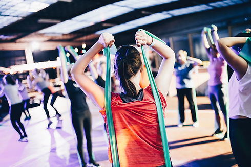 Men and Women Group Fitness Training with Tension bands