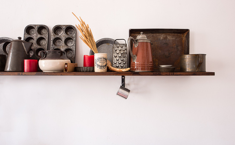 Kitchen items stored on a hanging shelf