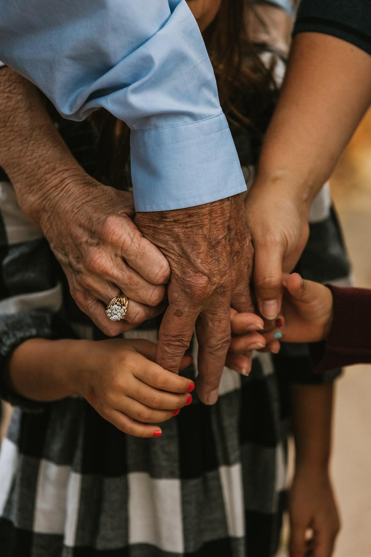 Kids holding hands with older adult.