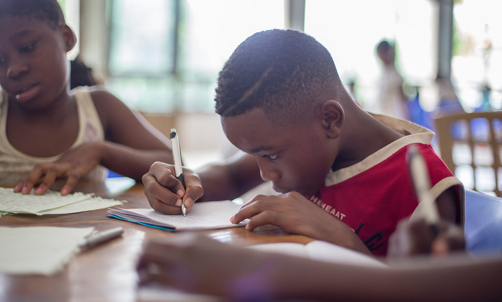 African american boy writing on paper online homeschool programs online homeschool classes online classes for kids grades 2 3