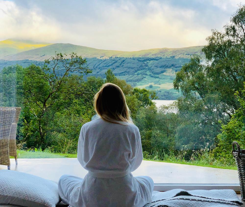 woman sat meditating outside