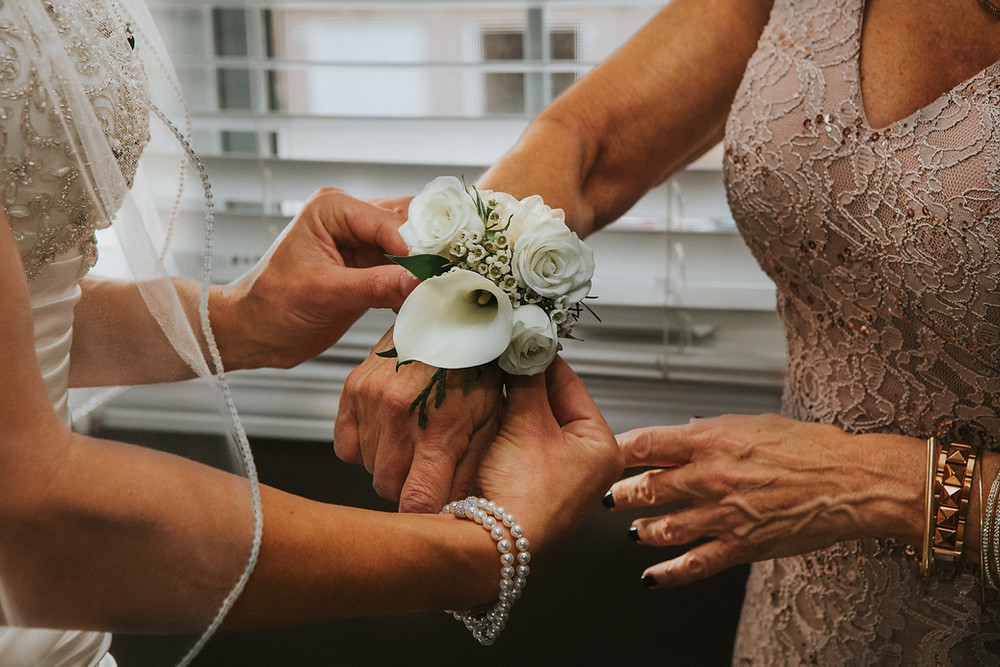 Wrist corsages can be a miniature version of the Brides bouquet for Mum