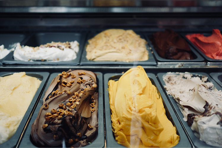 A variety of flavors of local ice cream for tasting and serving