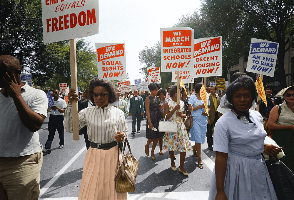 Beautiful Black people marching, holding signs, demanding equality.