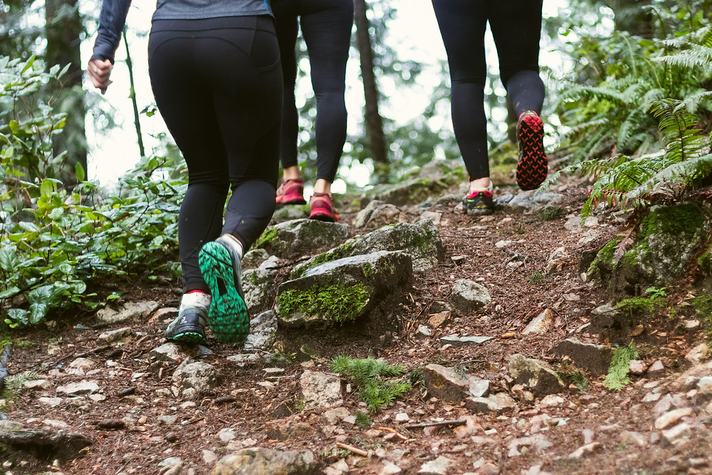 women hiking to get some exercise and promote good health