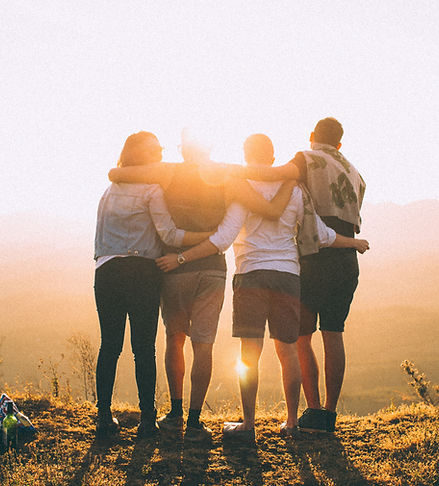 Group of friends looking over mountain (Helena Lopes)