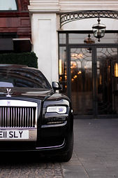 Black Rolls Royce with Hotel background Image by Zoe Holling