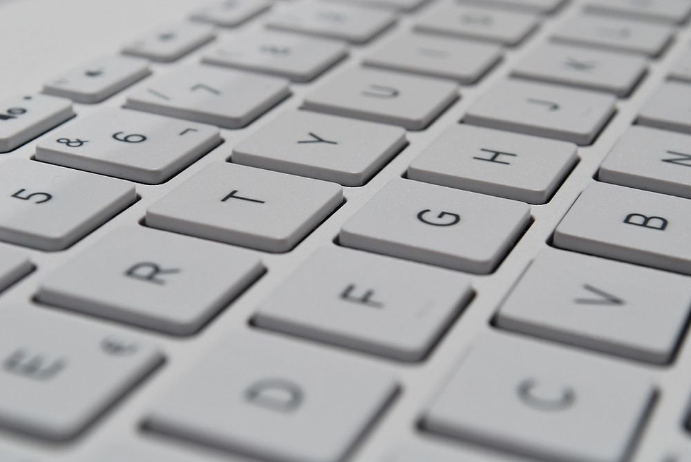 close up of a white computer keyboard letters