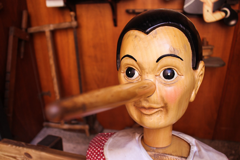 Lying Doll With Large Nose