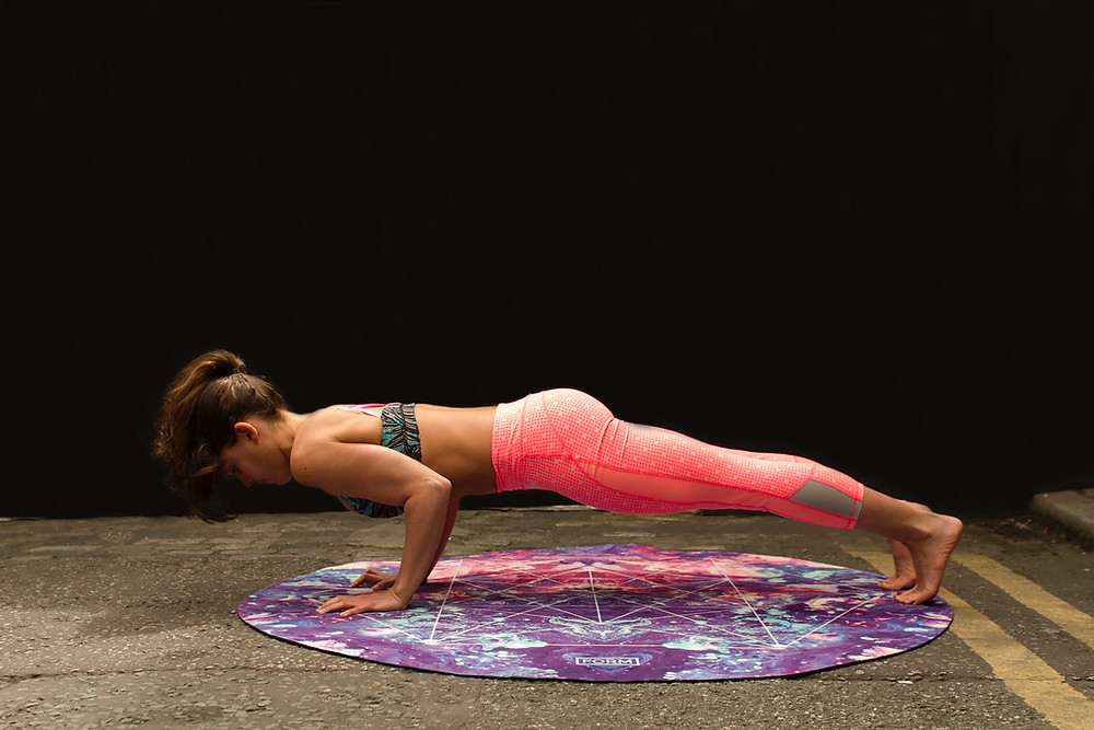 Girl planking on round mat
