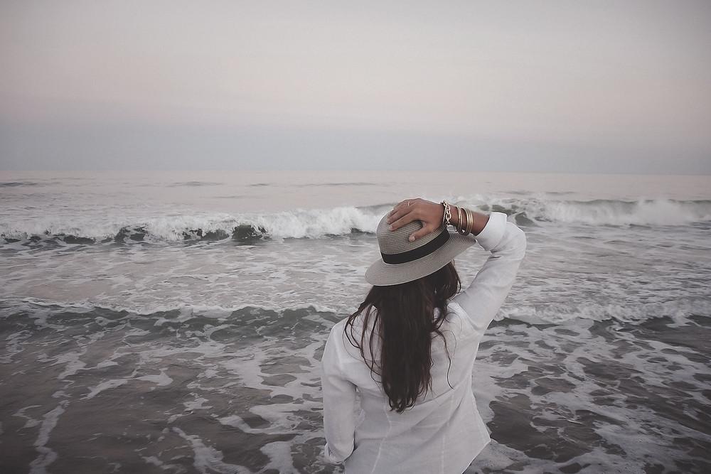 Woman looking at waves