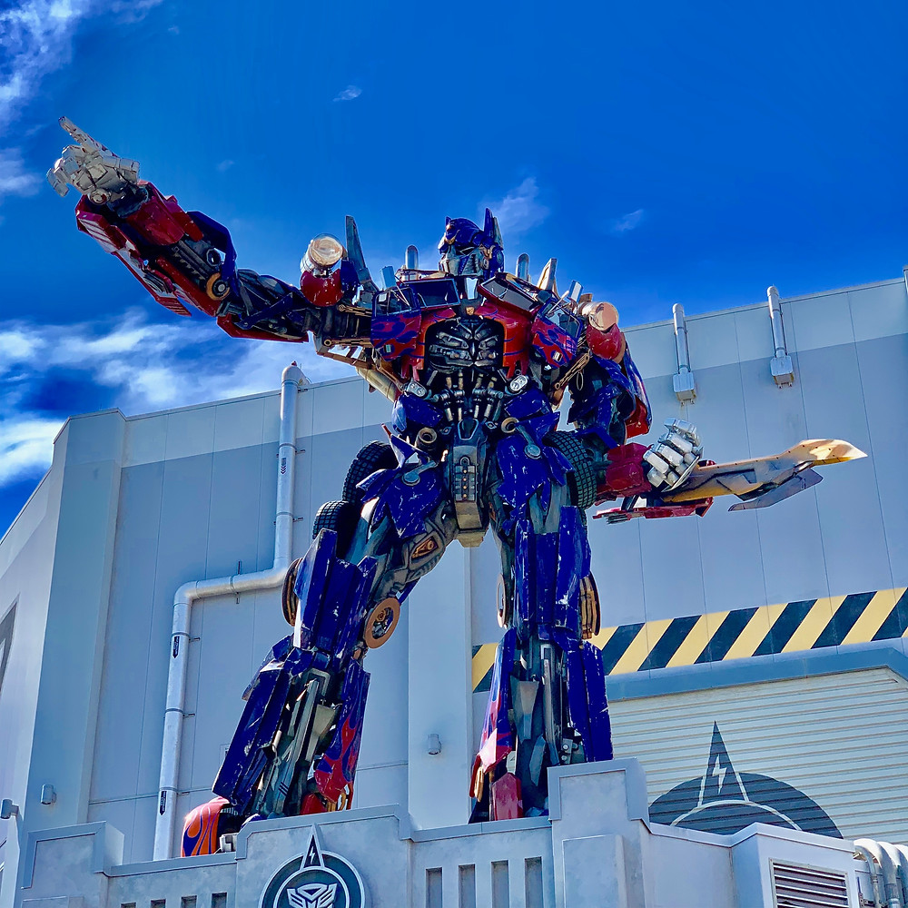 Optimus Prime standing and pointing at Universal Studios Florida