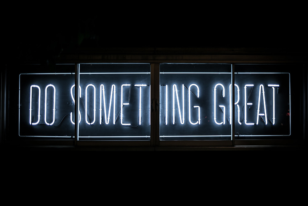 words in neon lighting: Do something great