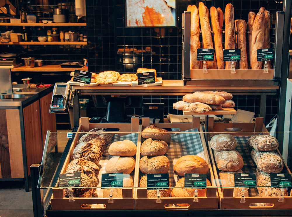 A selection of different types of bread in a bakery