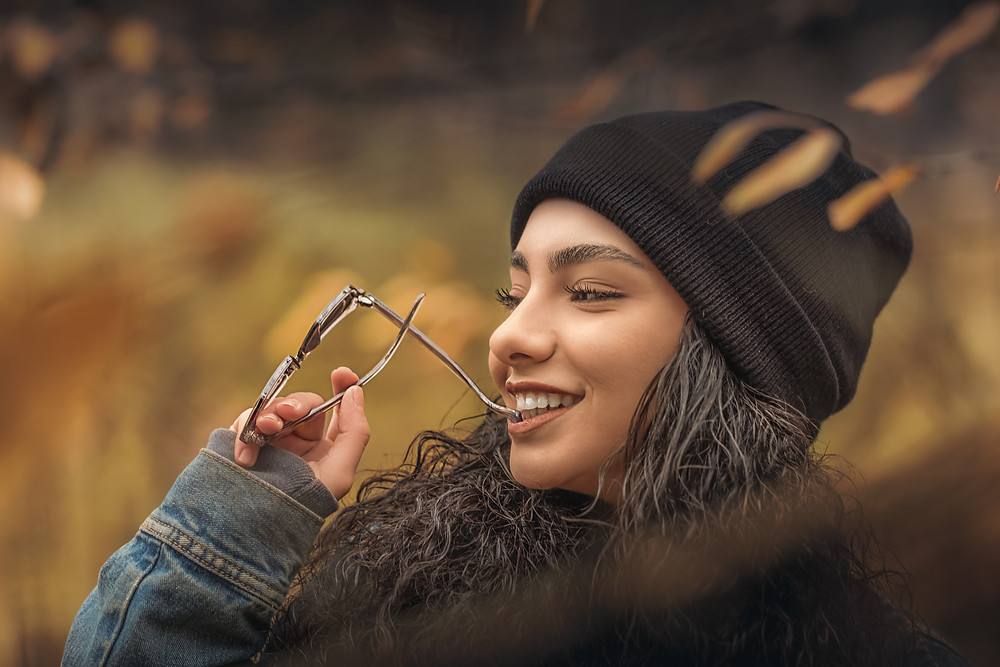 Satisfied woman gets in touch with her emotional well being.Catalyss Counseling provides treatment for depression in Colorado through online therapy and in person counseling in the Denver area 80209 and 80210