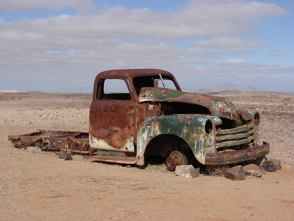 Rusty truck stuck in desert