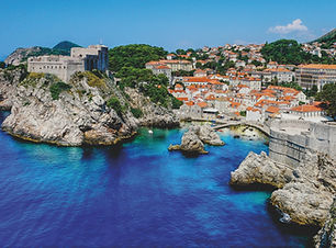 Stunning view of the coast of Dubrovnik, Croatia. The crystal clear waters of the Adriatic and red rooftops are showcased in this photo