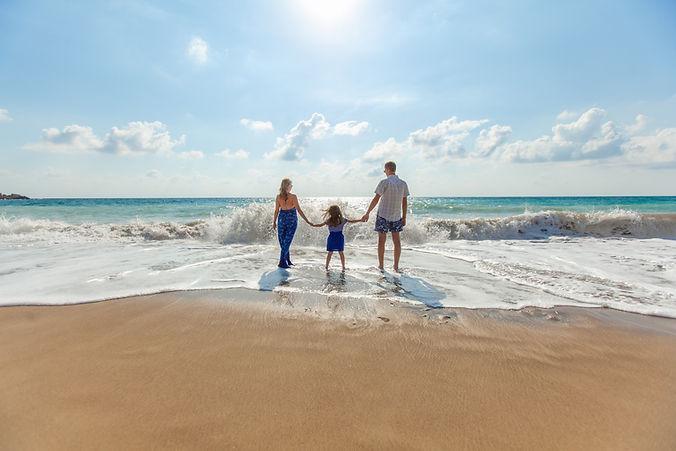 Family walking in waves