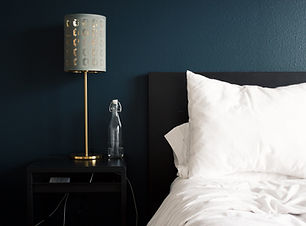 Realign Design can help you refresh your bedroom - night stand and bed